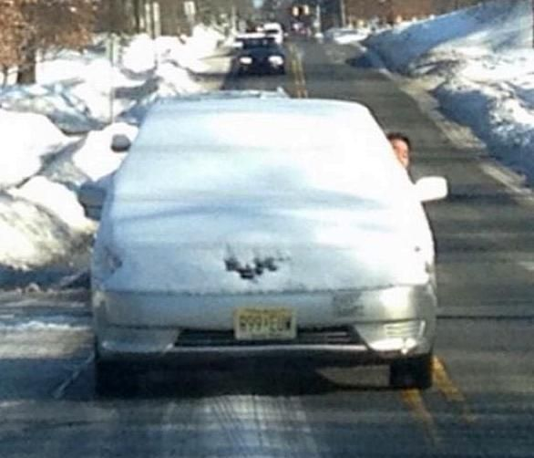 http://fightyourtickets.ca/man-charged-after-driving-with-car-almost-totally-covered-by-snow/