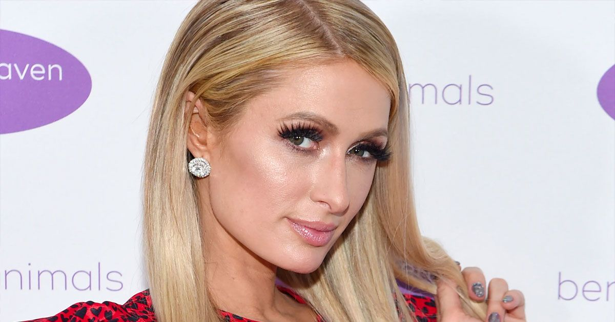 Paris Hilton Enjoys 'Sliving' As Her Team Works On Their Hands And Knees Behind Her